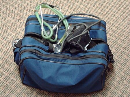 homecare: Blue Nurses bag With Stethascope and Blood Pressure Cuff On Top