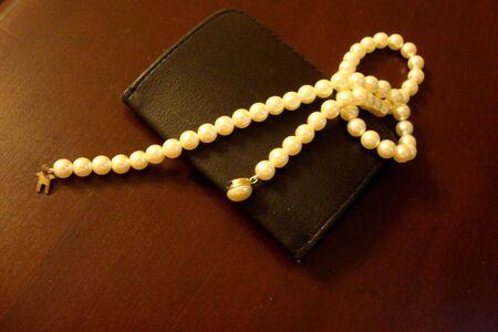 Pearls With Mans Wallet Banco de Imagens