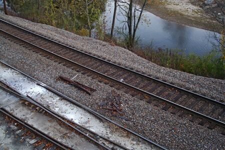 Close Up Of Railroad Tracks By The River Stock Photo