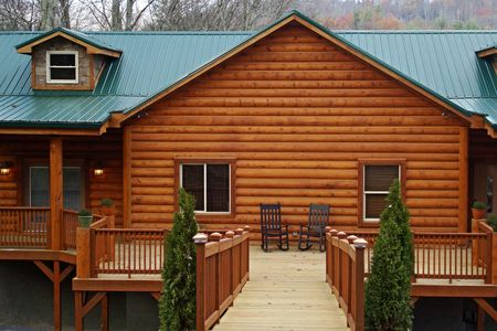 Log Home With Green Roof Stock Photo