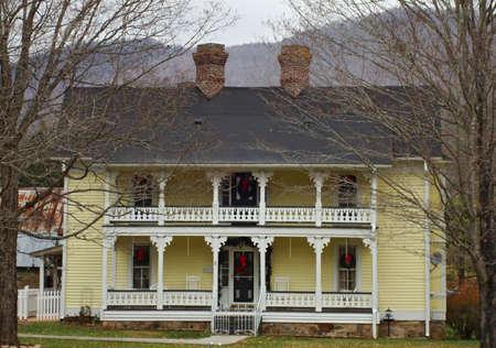 porches: Yellow Victorian Home Stock Photo