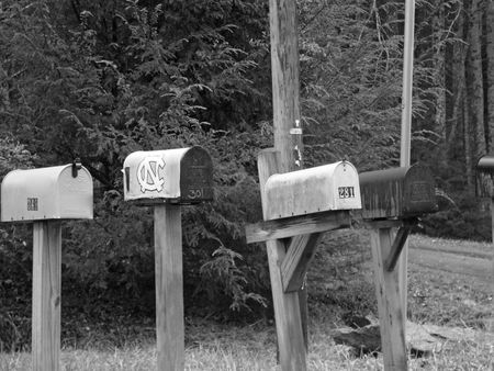 postmaster: B&W Rural Mailboxes Stock Photo