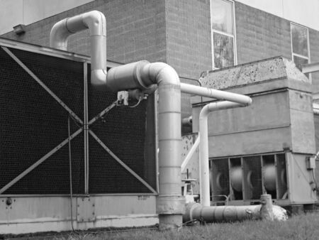 exhaust fan: Large Exhaust Fan And Pipes - B&W Stock Photo