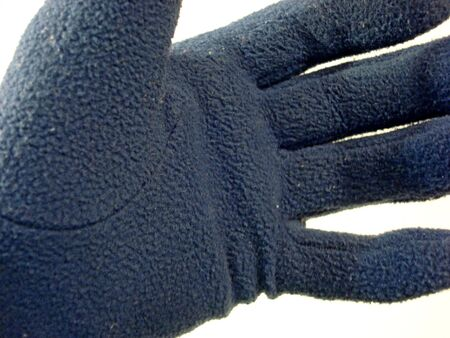gloved: Blue Gloved hand Stock Photo