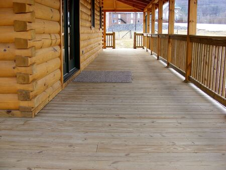 Long Front Porch Of Log Home