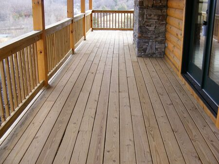 Looking At Floor Of Log Cabin Porch