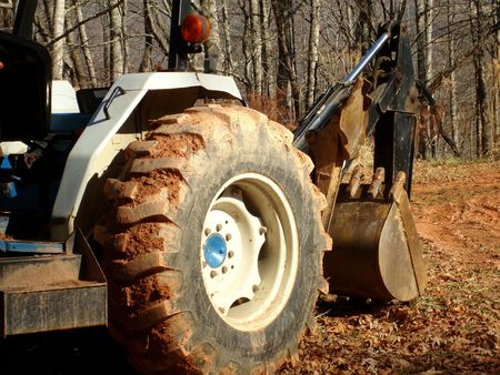 Tractor With Backhoe Attachment
