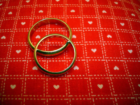 Wedding Rings On Red and White Heart Material photo