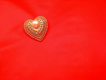 Gold And Pearl Heart on Red Фото со стока