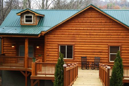 New Log Home With Large Wood Deck