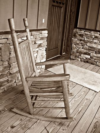 rocking chair: Rocking Chair On Deck - Sepia Stock Photo