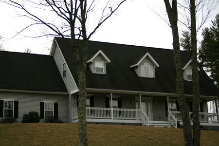 home With Dormer Windows on Hill