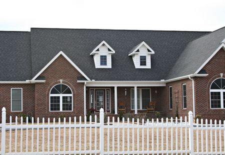 dormer: New Modern Red Brick Home