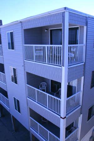 condos: Beachfront Condos Three Stories Stock Photo