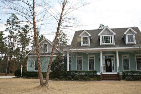dormer: Modern Home With Three Dormer Windows Stock Photo