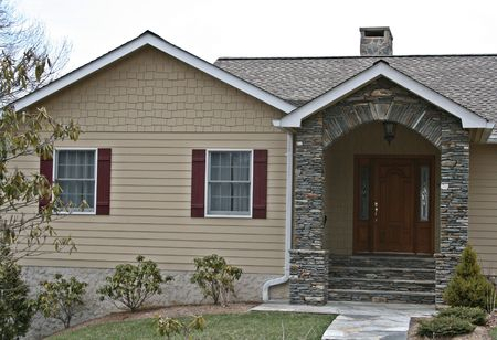 Home With Rock Arch Entry Way