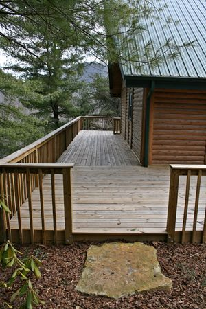 Step Up To Log Home Deck Stock Photo