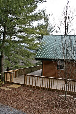 Log Home With Large Wood Deck photo