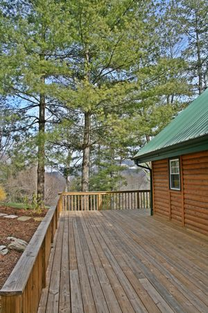 log deck: Deck Of Log Cabin Stock Photo