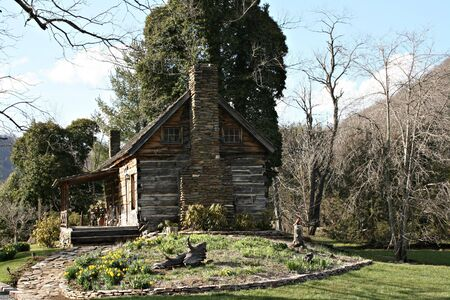 log Cabin With Rock Chimney photo