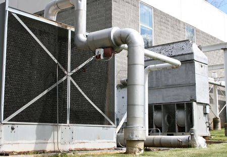 exhaust fan: Large Exhaust Fan And Pipes Stock Photo