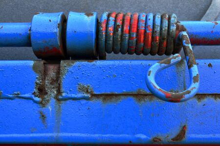 metal spring: A close up image of an old painted metal spring.