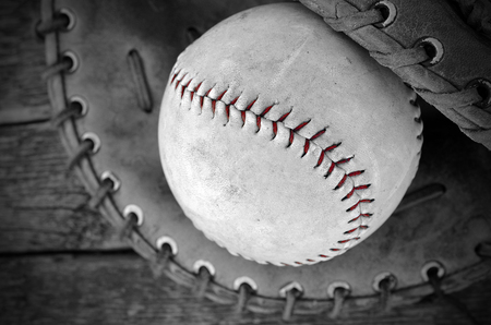 baseball glove: A top view image of an old baseball and baseball glove. Stock Photo