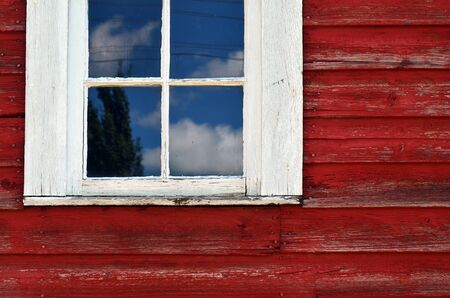 white window: An abstract image of an old white window on a red building.