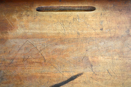 An abstract image of a vintage school desk top.