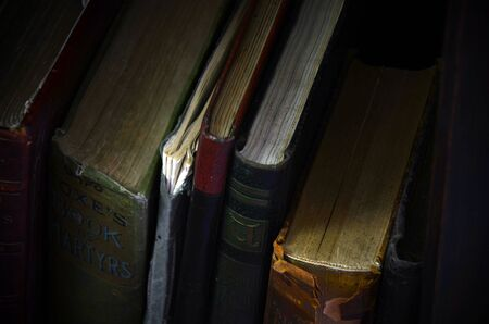 book binding: An abstract image of vintage books on a book shelf. Stock Photo
