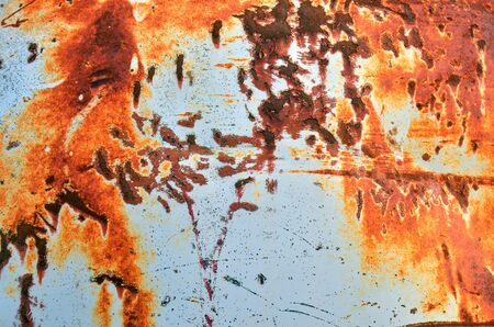 close up image: A close up image of interesting orange rust texture.