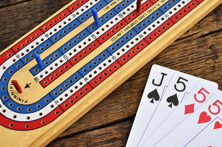 A top view image of a cribbage board and pegs.