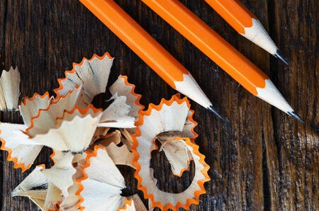 sharpened: A top view image of a sharpened pencil and pencil shavings.