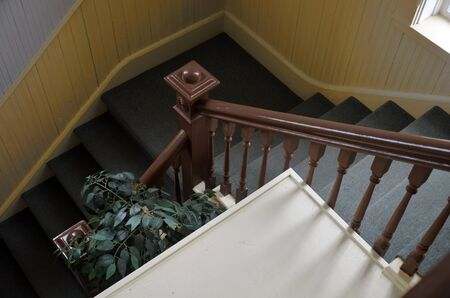 hand rails: An image of a stair case.