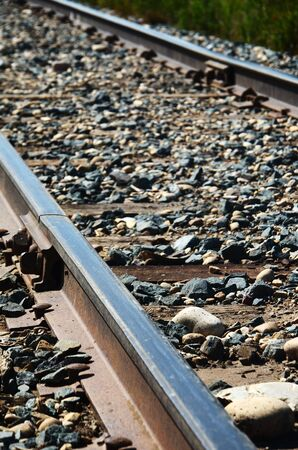 low angle: A low angle view of a set of train tracks.