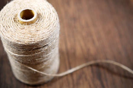 spool: A side view image of a spool of craft thread. Stock Photo