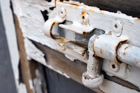 latch: A close up image of an old door latch.