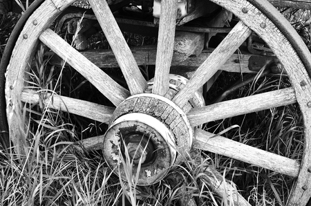 mode made: A black and white image of an old wooden wagon wheel. Stock Photo
