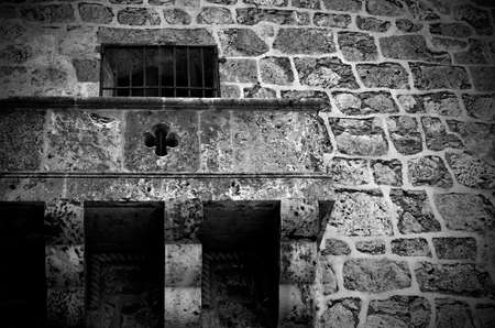 exterior architectural details: A black and white image of a stone balcony from an old stone building. Stock Photo