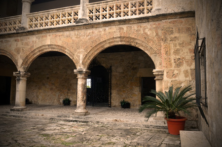 exterior architectural details: A partial image of a stone courtyard and stone arches.