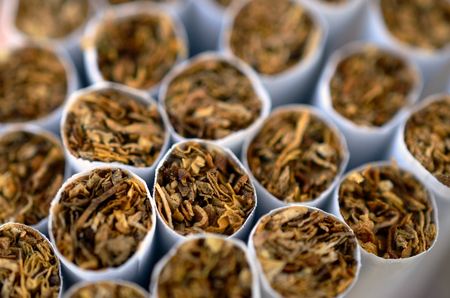 commercially: An abstract image of commercially produced cigarettes.