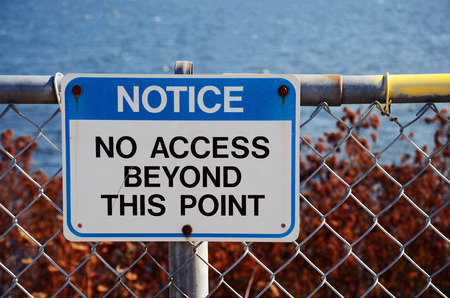 An image of a blue no access sign on a chain link fence. Stock Photo - 65083495