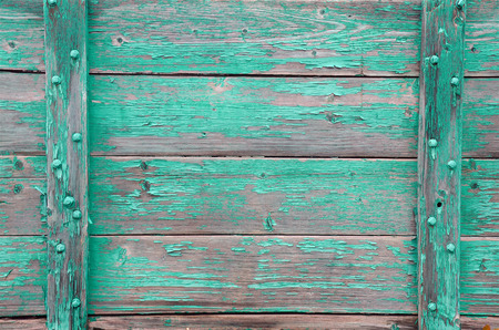 peeling paint: An abstract image of old weathered wood with green peeling paint.