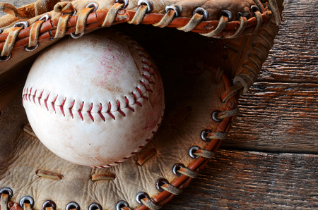 17839bf9704 A top view image of an old used baseball and leather baseball glove.