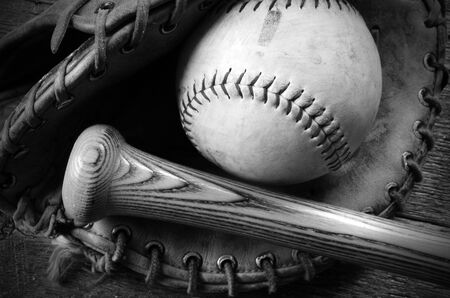 catcher's mitt: A top view image of an old used baseball, baseball glove, and bat. Stock Photo