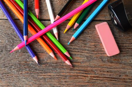 A top view image of several brightly coloured pencil crayons.