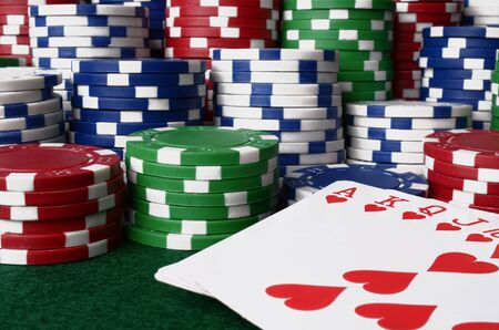 royal flush: A close up image of stacked poker chips and a royal flush. Stock Photo