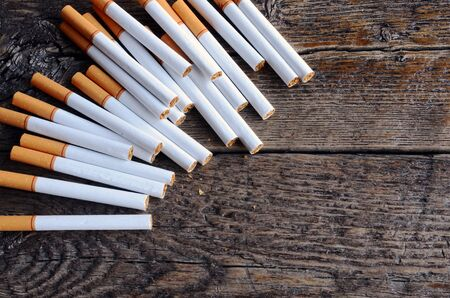 commercially: A top view image of several commercially made cigarettes.