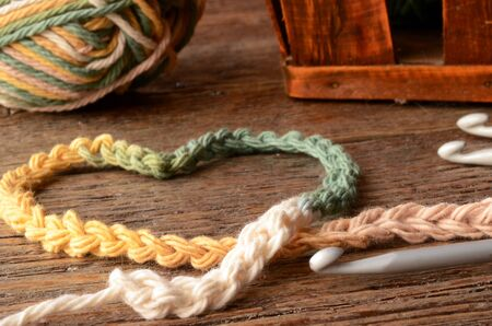 low angle: A low angle image of crochet yarn and hook.