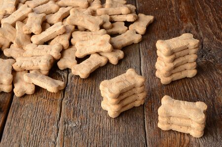 A top view image of several bone shaped dog treats. Stock Photo